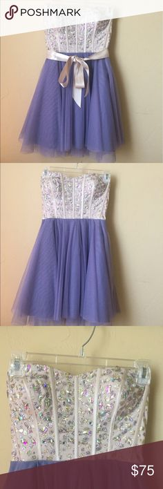 Crystal Cream and Lavender Prom Dress This short prom dress is a strapless, short dress with crystal details on the chest. There's a cream ribbon to tie around the waist to add a little something extra to it. This dress is almost knee length. Dresses Prom