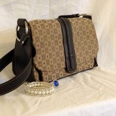 'On the Town' Villager by Liz Claiborne purse Great condition-- the only sign of use is a small pen mark on the inside by the clasp, which is pictured above. It's about 9 inches long and 6 inches deep with two internal sections with pockets for the essentials and one external pocket. Don't miss out on this great deal! Liz Claiborne Bags