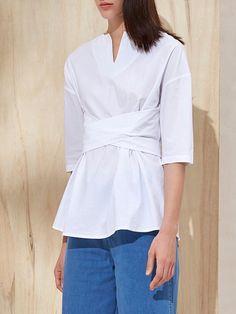 Shop Blouses - Bandage Work Half Sleeve Solid Cotton Blouse online. Discover unique designers fashion at StyleWe.com.