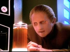 "Security Chief Odo, Star Trek: Deep Space Nine, played by René Auberjonois, is a member of a shapeshifting race, The Changelings, serves as head of security for the space station. Odo was found adrift in 2356 in the Denorios Belt by Bajorans in his natural gelatinous state since he had not yet morphed into human form. Cardassian overseers translated ""unknown sample"" into ""odo'ital,"" which literally means ""nothing."" Even after it was clear that Odo was sentient, scientists kept calling him…"