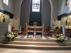 www.teresaferrando.com Church altar decorated with large arrangements of lush hydrangeas, roses, bells of Ireland and delicate greens.