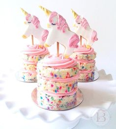 Unicorn toppers on cake with rainbow sprinkles