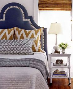 Love the navy and orange mix. So cozy and inviting!  High Street Market: Inspired Bedding