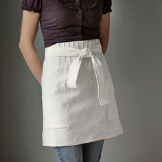 Apron.   (i need something like this for festivals so i don't have to worry about wearing pockets!)