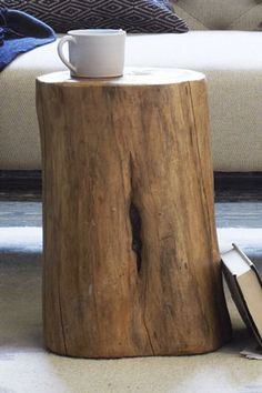 21 Rustic Home Goods That Bring The Ski Lodge To You #refinery29 <---- OMG I WANT THIS STUMP