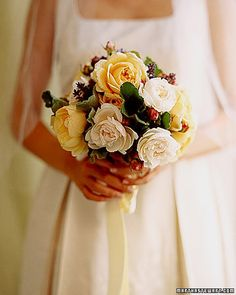 All eyes are drawn to the golden highlights of yellow 'Celebration' roses clustered with creamy 'English Garden' roses and buds. French lavender adds flecks of complementary color -- and intensifies the pleasure of scent. #Bridalbouquet #bridesbouquet #bridalflowers #weddingflowers