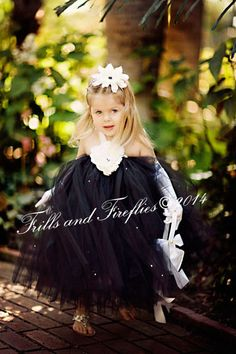 Black Flower Girl Tutu Halter Dress with Rhinestones and White Flowers.  This dress can be make in 44 different color of tulle and flowers to match your wedding theme by Frills and Fireflies
