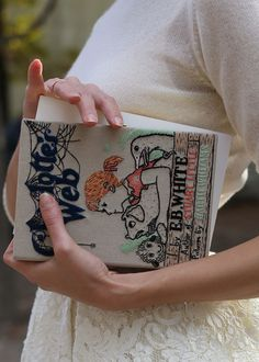 "Charlotte's Web embroidered book clutch by Olympia Le-Tan. They also make ""Terrific"" and ""Radiant"" embroidered heels!"