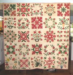"Friendship album quilt, 1840s, $21,000. This bedcover is known as a Baltimore album quilt because the design was popular in and around Baltimore during the 1840s and 1850s. Each block was made  and signed by a different person and, when finished, was given as a gift. This was made in New London, PA, less than a half hour from Baltimore, and has the dates 1847, 1848, and 1849 written in ink in most of the quilt blocks. 83"" x 82""."