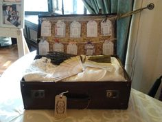 Old Suitcase Containing Wedding Dress Bunch Of Lavender