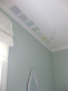 color on the ceiling (either coordinating tone to walls or same with added white) to make moulding pop