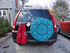 Car Doily by Indigonightowl; pattern on Ravelry If I ever have a car worth a spare tire it will have this in it!