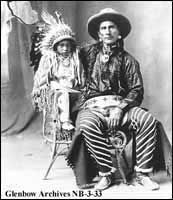 Image No: NB-3-33  Title: Bobtail Chief with grandson, Billy Scout, Blood reserve, Alberta.  Date: n.d.  Photographer/Illustrator: Atterton, J. F. Cardston, Alberta.
