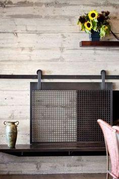 Board Formed Concrete sliding Fireplace | Screen