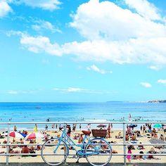 A blue vintage bike by the sea at Bondi Beach, Sydney Australia, #azulsietedestination #azulsiete #beach #swimwear #beachwear #oceanstyle