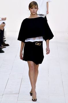 """The idea behind the collection was """"pull-on and go"""" - meaning easy and effortless items, be they swingy caped crop tops, Bermuda-style shorts, oversized tunic tops, inside-outside lattice work skirts and dresses, or frilled and flounce-festooned dresses that flirted and flitted as the models walked."""