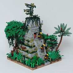 Mardier soldiers are searching in an ancient jungle for a rumored city of gold. Rumors are as usual exaggerated, but they do find a very interesting temple to investigate further. Built for a challenge in Brethren of the Brick Seas, on Eurobricks. Legos, Jungle Temple, Lego Tree, Minecraft, Lego Castle, Lego Worlds, Lego Photography, Lego Projects, School Projects