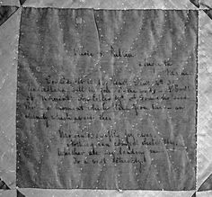 A close-up photo reveals one of the inscriptions on the quilt