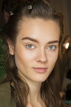 An almost masculine take on minimal beauty with full brows, glowing skin and contoured cheeks at 3.1 Phillip Lim Fall/Winter 2014-15