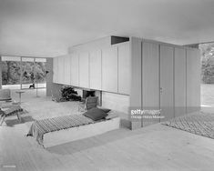 Interior view of living space of Farnsworth House, December 20, 1951. The view shows firespace, cabinet walls, and casual modern furniture. Farnsworth House was built in 1950 at 14520 River Road in Plano, Illinois, designed by Mies van der Rohe. Edith Farnsworth was the client. (Photo by Chicago History Museum/Getty Images)