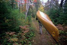 Portaging a canoe in the Boundary Waters Canoe Area BWCA. #morefallcolors #exploremn Photo by Explore Minnesota