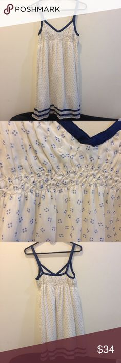 ecote Navy Cream Diamond Printed Dress Ecote from Urban - cream dress with a navy diamond like pattern all over. Straps are nylon like and are adjustable by buttons. Very cute and worn twice ever. Ecote Dresses Midi