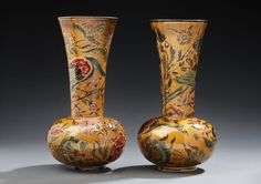 Vilmos ZSOLNAY (1840-1900)  A pair of enamelled ceramic vases decorated with birds and polychrome floral motifs. Signed Z.W. Pecs and numbered. Circa 1865-1885. H: 13 ½ in