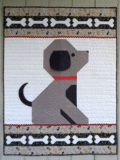 "Give a Dog a Bone, 40 x 52"", pieced quilt pattern at Annie's Catalog. Includes a 3-dimensional floppy ear."