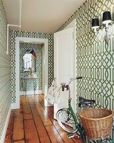 Hallway of Chloe Sevigny featured in Domino.  Kelly Wearstler's Imperial Trellis is the bees knees!
