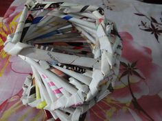 This is an amazing paper pot which is made with rolled up paper and goes around like a staircase .