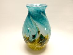A beautiful spring vase! Full of color and motion this is a wonderful wedding present!    Check out this item in my Etsy shop https://www.etsy.com/listing/229261888/mountain-meadow-art-glass-vase-handblown