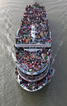 Passengers crowd on to a ferry leaving Dhaka, Bangladesh, on Aug. 16, ahead of the Eid al-Fitr holiday.