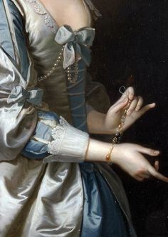 Dressed for a masquerade, by the Van Dyke puffed sleeve and lace detail, matching bows to bodice and at elbow, pearls looped from bodice bow, pearl, carnelian (?) gold bracelet being attached at wrist. From Portrait of a Woman, Probably Elizabeth Aislabie, of Studley Royal, Yorkshire (detail), 1749, Thomas Hudson