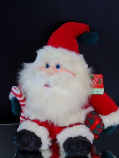 Santa Claus Plush Doll w Gift Box and Candy Cane 1995 Fiesta Toy 14 inch Tall Lovable Plushie Christmas Decor by 777VintageStreet on Etsy https://www.etsy.com/listing/467624452/santa-claus-plush-doll-w-gift-box-and
