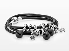 Black leather bracelet with dangle charms; hearts, stars and facetted drops. #PANDORAbracelet