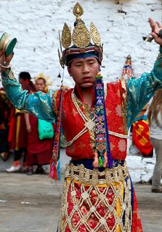 Bhutan Paro festival: dancer with hand bells. From Bhutan's Paro Tshechu Festival - An Expression of Gross National Happiness in the Land of the Thunder Dragon