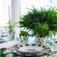By Carolyne Roehm.....I  always wondered if it was tacky to put a potted plant on the table, but if Carolyne says do it: then it must be ok.