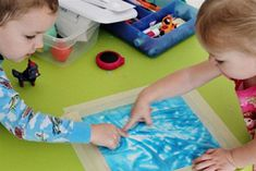 Mess-Free Art - plastic Ziploc bag (freezer bags work best, since the plastic is stronger), paint or a similar colored substance ( shaving cream, Jell-o, jelly, etc.) food coloring (optional) sheet of white paper, tape