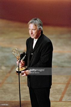 In this file picture taken on September 8, 1996 British actor Alan Rickman looks prepares to speak after receiving an Emmy award during the ceremony in Pasedena, for his title role in the movie Rasputin: Dark Servant of Destiny. Veteran British character actor Alan Rickman, known for his memorable portrayal of screen villains, has died at the age of 69 after suffering from cancer, his family said on January 14, 2016. Rickman, who won a Golden Globe and a BAFTA during his career as a film…