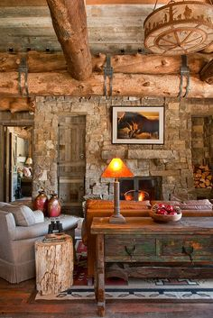 I love the details in this cabin...and using a tree stump as an end table! <3