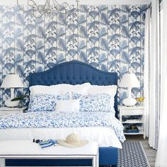 A tufted upholstered bed, graphic rug, and splatter paint–patterned bedding from designer McCarthy's own line reinforce the monochromatic palette.   Coastalliving.com