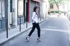 Buckles make the basic black pant feel new again. Laberiane of blog The Blab in the Tibi Anson buckle pant.