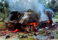 """-113 Armored Personnel Carrier (APC) destroyed by an enemy rocket propelled grenade (RPG).    This APC belonged with the 1st Cav. out of An Khe and was on convoy patrol along QL 19 when the attack occurred.    The M-113 was the first modern """"Battle Taxi"""" and the Viet Cong often referred to it as the """"Green Dragon."""""""