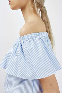 Make an instant style statement in this longline poplin bardot top. In a cute blue and white stripe pattern, we love to style it with colourful trousers and ankle boots. #Topshop