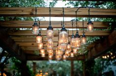 I love the homemade mason jar lights hanging from the pergola. Now I just need some jars and lights and pergola wood. Dan take note, happy wife happy life Patio Pergola, Pergola Kits, Pergola Ideas, Patio Ideas, Cheap Pergola, Wood Pergola, Deck Overhang Ideas, Outdoor Ideas, Wooden Gazebo
