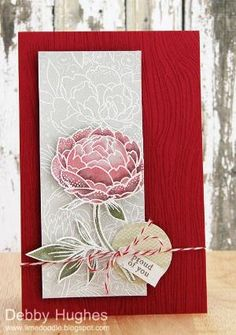 HA Large Flowers BG (white heat embossed on Soft Stone CS, coloured with Distress Markers, added a touch of perfect pearls for a little shimmer, cut out and mounted over panel of the background, panel mounted on Raspberry Ripple CS stamped with HA Designer Woodgrain in Versamark) by ivy