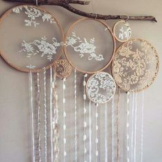 Dreamcatcher wall hanging using lace, embroidery hoops, and a large stick