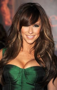 love the side-swept bangs and her layers are perfect for giving her lots of volume!