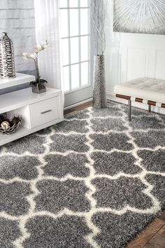 Add depth to your space when you lay down the polypropylene and polyester, machine made rug in your room. The low pile rug is available in two shades of grey and over six different sizes to add a stylish variety to your interiors.