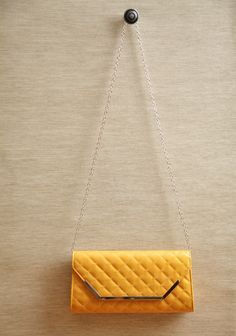 """Yacht Club Quilted Clutch In Yellow 29.99 at shopruche.com. Beautifully structured, this yellow quilted leatherette clutch is perfected with silver colored hardware, a snap closure, and an optional chain strap.All man made materials, 11.5"""" L x 2""""W x 6"""" H, 21"""" strap drop, Magnetic snap closure,  1 inside pouch"""